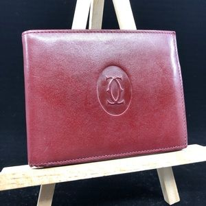 Cartier Paris burgundy billfold leather wallet
